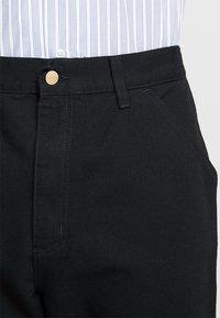Carhartt WIP - SINGLE KNEE PANT DEARBORN - Jeans Straight Leg - black rinsed - 6