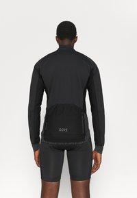 Gore Wear - INFINIUM™ THERMO JACKET - Soft shell jacket - black - 2