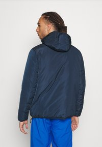 Champion - HOODED JACKET - Winter jacket - navy - 2