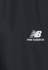 New Balance - ATHLETICS WIND PANT - Tracksuit bottoms - black - 2