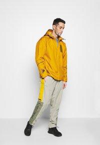 adidas Performance - ATHLETICS TECH PRIMEBLUE SPORTS JACKET - Veste de survêtement - legacy gold/black - 1