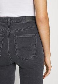 American Eagle - SUPER HI-RISE - Slim fit jeans - blue black - 3