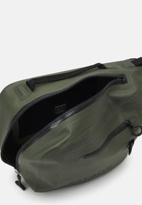 Filson - DRY SLING PACK - Across body bag - green - 3