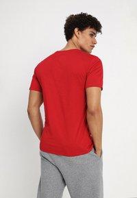Jordan - JUMPMAN AIR TEE - Jednoduché triko - gym red/black - 2
