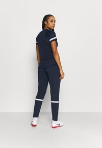 Nike Performance - PANT - Tracksuit bottoms - obsidian/white - 2