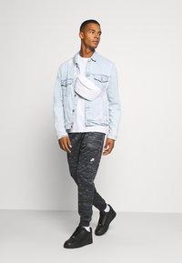 Nike Sportswear - Tracksuit bottoms - black/iron grey - 1