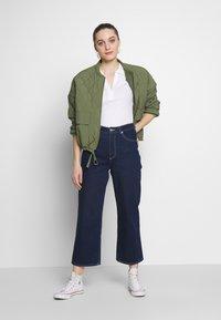 Calvin Klein - ESSENTIAL - Polo shirt - calvin white - 1