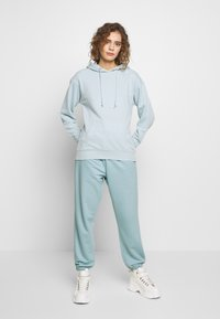 Missguided - OVERSIZED JOGGER - Tracksuit bottoms - blue - 1