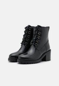 maje - Lace-up ankle boots - noir - 2