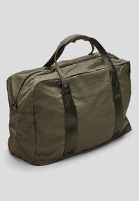 s.Oliver - Weekend bag - khaki - 1