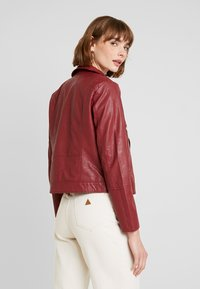 JDY - YONG JACQUELINE - Faux leather jacket - pomegranate - 2