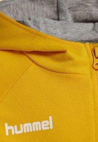 Hummel - HMLGO - Sweat à capuche zippé - sports yellow - 3