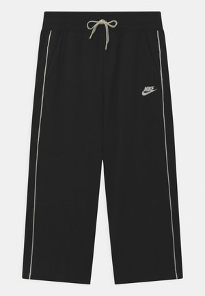 GLOW IN THE DARK  - Tracksuit bottoms - black/coconut milk