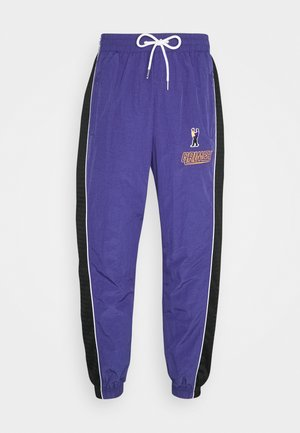 UBIQUITY TRACK PANTS UNISEX - Tracksuit bottoms - purple