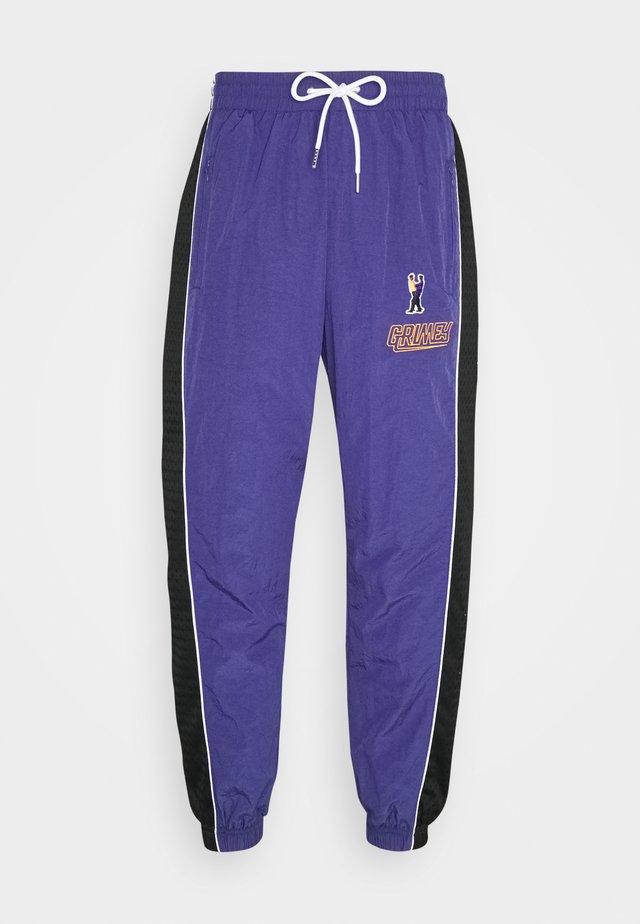 UBIQUITY TRACK PANTS UNISEX - Verryttelyhousut - purple