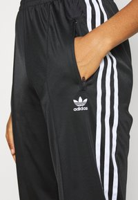 adidas Originals - FIREBIRD - Tracksuit bottoms - black - 3