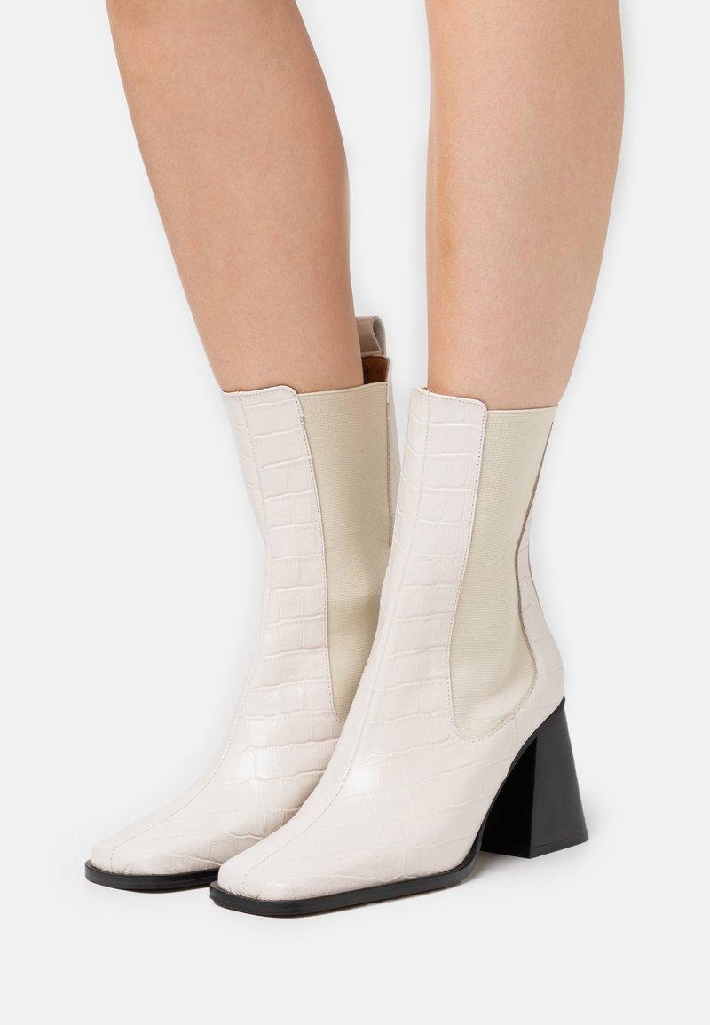 ÁNGEL ALARCÓN - High heeled ankle boots - crema