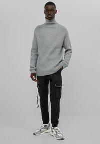 Bershka - Cargo trousers - black - 1