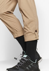 Jack Wolfskin - DESERT ROLL UP PANTS - Outdoor trousers - sand dune - 5