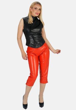 LINA - Leather trousers - orange
