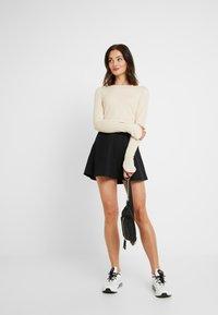 NA-KD - Pamela Reif x NA-KD HIGH WAIST SKATER MINI SKIRT - A-line skirt - black - 1