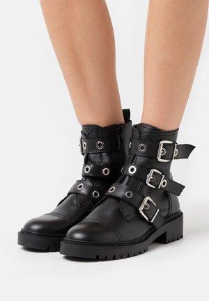 GUISA - Cowboy/biker ankle boot - black