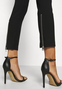 Diesel - P-CUPERY TROUSERS - Trousers - black - 5