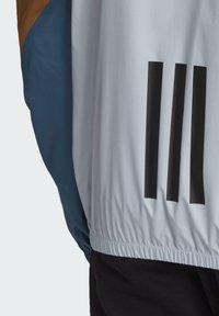 adidas Performance - Windbreakers - blue - 3