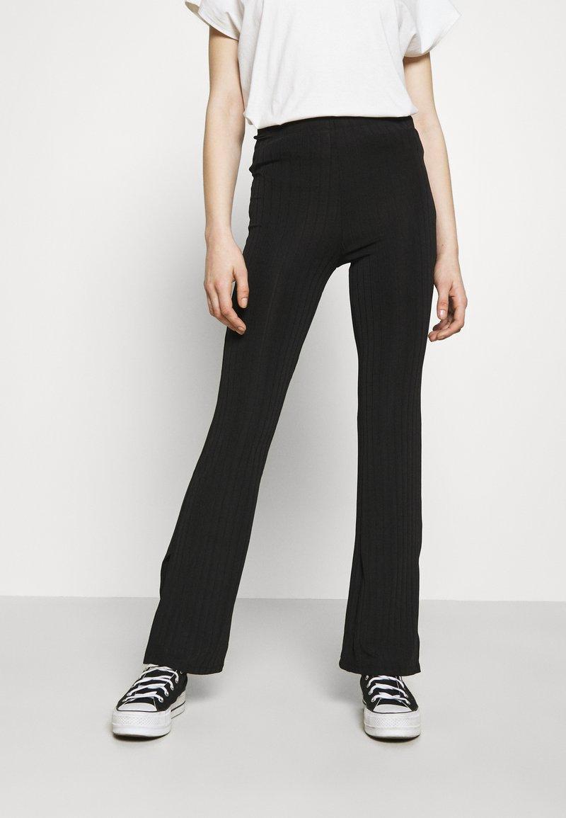 Monki - CASMIN FLARES - Trousers - black