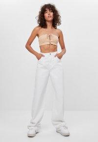 Bershka - Flared Jeans - stone - 1