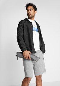 Puma - REACTIVE PACKABLE PANT - Outdoor trousers - castlerock black/white - 3