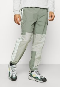 The North Face - STEEP TECH LIGHT PANT - Cargo trousers - agave green/wrought iron/green mist - 0
