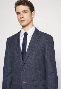 Tommy Hilfiger Tailored - BLEND  SLIM FIT SUIT - Suit - blue - 9