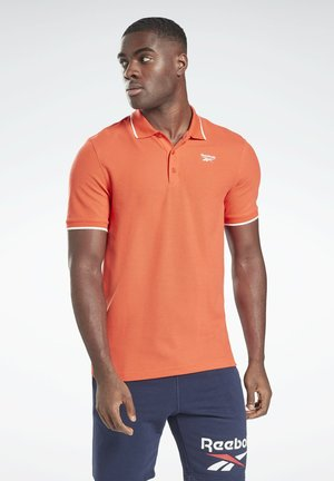 TRAINING ESSENTIALS POLO SHIRT - Polo shirt - orange