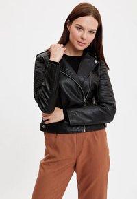 DeFacto - Faux leather jacket - black - 0