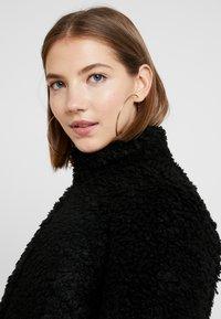 Vero Moda - VMVIRIGINIATEDDY HIGH NECK - Winter jacket - black - 3