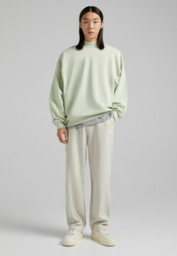 Bershka - Relaxed fit jeans - sand - 1