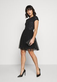Lace & Beads Petite - NESSIA - Cocktail dress / Party dress - black iridescent - 1