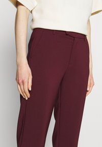 Anna Field - Slim fit business trousers - Trousers - dark red - 4