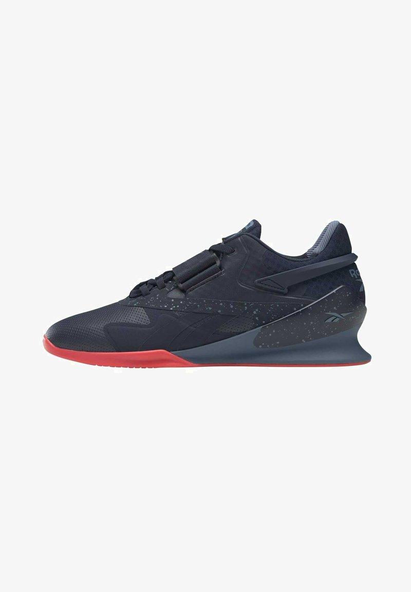 Reebok - LEGACY  - Sports shoes - blue