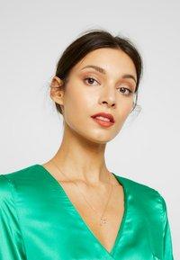 P D Paola - LETTER NECKLACE - Necklace - gold - 1