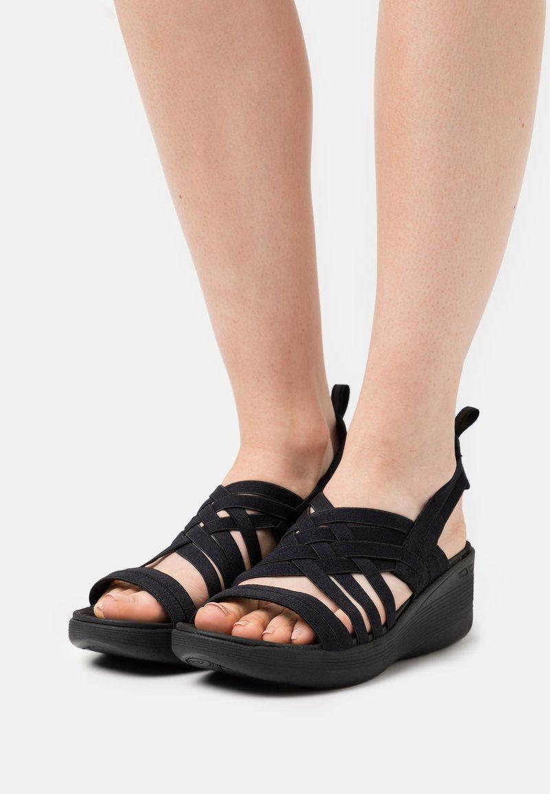 Skechers - PIER LITE - Platform sandals - black gore