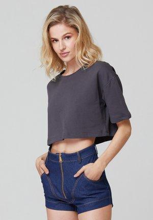 CRISTI - Basic T-shirt - mottled black