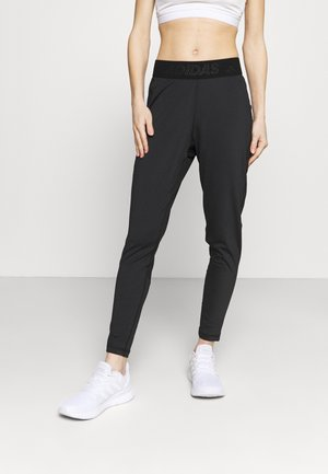 BAR - Tracksuit bottoms - black/white