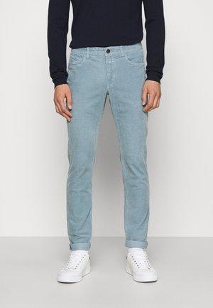 UNITY SLIM - Trousers - dutch procelain