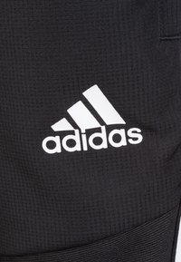 adidas Performance - TIRO 19 WOVEN TRACKSUIT BOTTOMS - Tracksuit bottoms - black / white