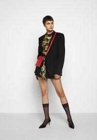 Versace Jeans Couture - T-shirt z nadrukiem - nero - 1