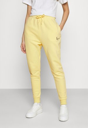 SIGNATURE SWEATPANTS LIGHT - Tracksuit bottoms - yellow
