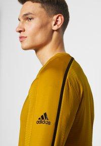 adidas Performance - DESIGNED 4 TRAINING COLD.RDY SPORTS - Sudadera - gold - 3