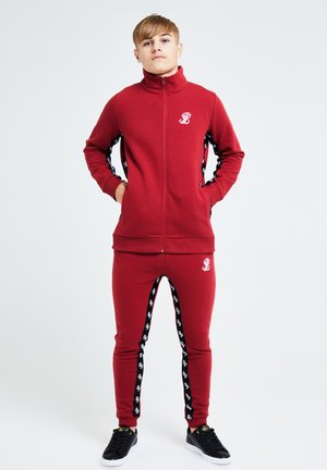GRAVITY - Tracksuit bottoms - red